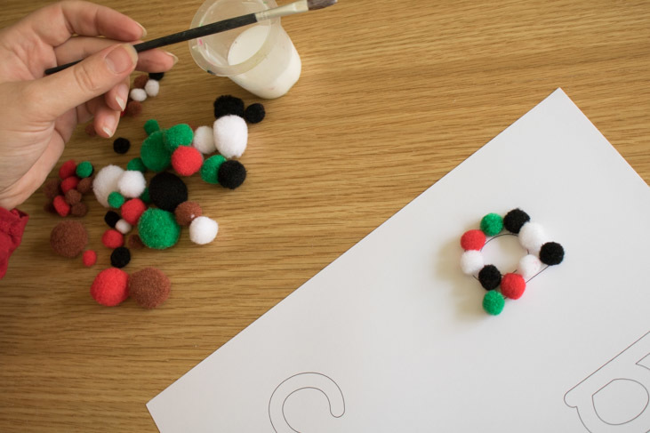 making a sensory alphabet using pom poms and our free to download alphabet template